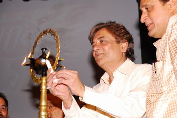 1 Chairman Mr Devendra Khandelwal lighting the lamp being watched by Nathusingh Gurjur